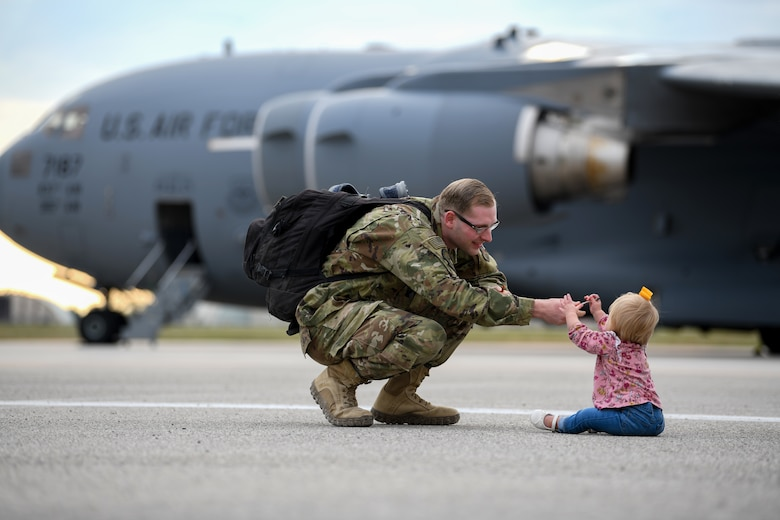 U.S Airmen plays with his daughter as he reunites with his family after a deployment at Aviano Air Base, Italy, Oct. 8, 2019. The HH-60G is also tasked to perform military operations other than war, including civil search and rescue, medical evacuation, disaster response, humanitarian assistance, security cooperation/aviation advisory, NASA space flight support, and rescue command and control. (U.S. Air Force photo by Airman 1st Class Ericka A. Woolever).