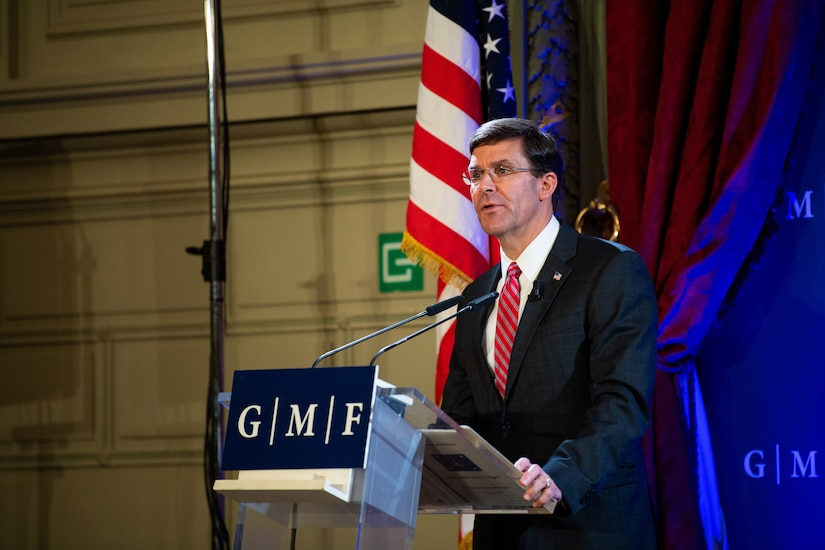 Defense Secretary Dr. Mark T. Esper speaks from behind a lectern.