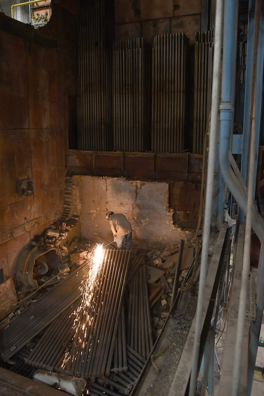 An image of a construction worker in the demolition site of Boiler #1.
