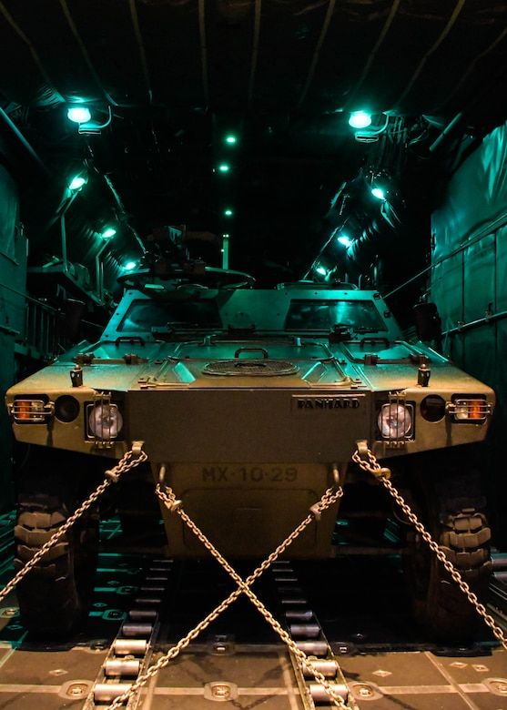A Portuguese M-11D Light Reconnaissance Vehicle is strapped into a C-130H3 from Dobbins Air Reserve Base, Georgia, before taking off for a Night Tactical Air-Land Mission during Exercise Real Thaw 2019 at Beja Air Base, Portugal, Oct. 2, 2019. Real Thaw is a Portuguese-led large joint and combined force exercise held annually where Dobbins provided aerial support. (U.S. Air Force photo/Senior Airman Josh Kincaid)