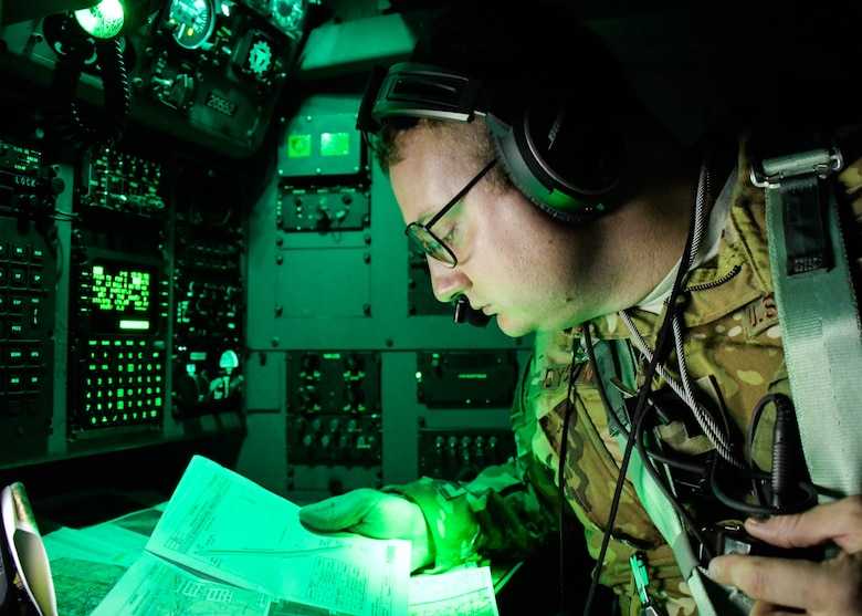1st Lt. Patrick Dyson, a 700th Airlift Squadron navigator and mission planning cell member, navigates during a Night Tactical Air-Land mission during Exercise Real Thaw 2019 at Beja Air Base, Portugal, Oct. 2, 2019. Real Thaw is a Portuguese-led large joint and combined force exercise held annually where Dobbins provided aerial support. (U.S. Air Force photo/Senior Airman Josh Kincaid)