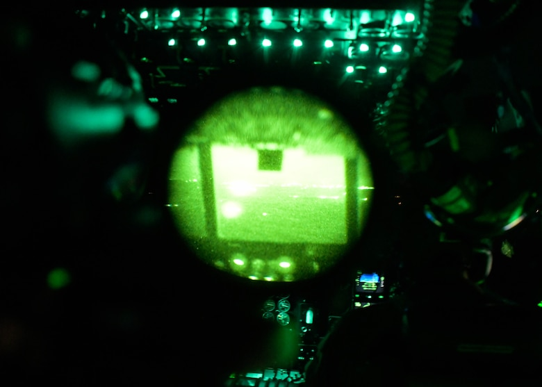 The view from a pair of night vision goggles while in the cockpit of a C-130H3 Hercules from Dobbins Air Reserve Base, Georgia, during a Night Tactical Air-Land Mission during Exercise Real Thaw 2019 at Beja Air Base, Portugal, Oct. 2, 2019. Real Thaw is a Portuguese-led large joint and combined force exercise held annually where Dobbins provided aerial support. (U.S. Air Force photo/Senior Airman Josh Kincaid)