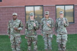 1st Theater Sustainment Command Soldiers show off coins they received from  Sgt. Major of the Army Micheal A. Grinston, for maintaining high standards of their quarters Oct. 23, 2019, at Fort Knox, Ky.