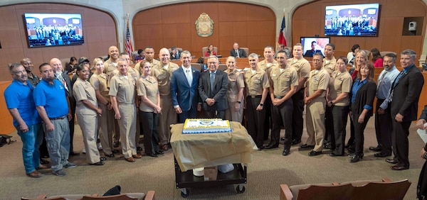 Sailors from Navy Medicine Education, Training and Logistics Command, Navy Medicine Training Support Center, Navy veterans and retirees, San Antonio Mayor Ron Nirenberg, and city council members after honoring the Navy's 244th birthday during a city hall meeting. Capt. Elizabeth Montcalm-Smith, NMETLC acting deputy commander, spoke on behalf of San Antonio Navy, thanking the mayor and city council members for their commitment to the Navy and the military.