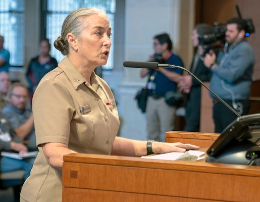 """Capt. Elizabeth Montcalm-Smith, Navy Medicine Education, Training and Logistics Command acting deputy commander, addresses San Antonio Mayor Ron Nirenberg and San Antonio City Council members during a city hall meeting that included recognizing the Navy's 244th birthday Oct. 17. Montcalm-Smith thanked the mayor and city council for their support of the Navy and military. The city recognition included a Navy birthday cake cutting, singing """"Anchors Aweigh,"""" and honoring Navy active, Reserve and veterans attending."""