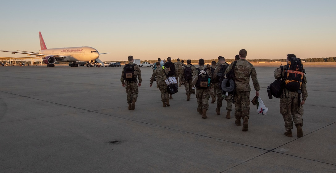 Members of the 79th Aircraft Maintenance Unit (AMU) walk towards a commercial aircraft on the flight line at Shaw Air Force Base (AFB), South Carolina, Oct. 17, 2019.