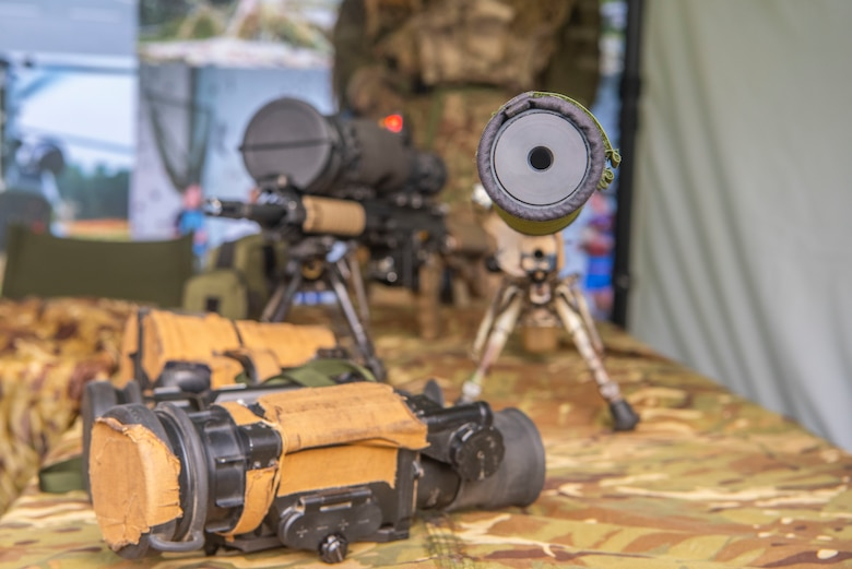 A collection of Royal Air Force Regiment weapons and scopes sits on a table at RAF Waddington, England, Oct. 22, 2019. Airmen received a briefing on airfield force protection during the RAF Air Combat Power visit. (U.S. Air Force photo by Airman 1st Class Joseph Barron)
