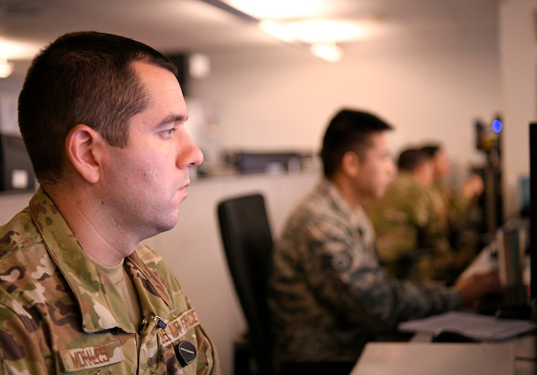 """U.S. Air Force Airmen at the 33rd Network Warfare Squadron conduct cyber operations at Joint Base San Antonio-Lackland, Texas, Aug. 27, 2019. Airmen from the 33rd NWS utilize a cyber weapon system that employs more than 40 tools and applications. The """"12N12"""" initiative aims to reduce this number to 12 in 12 months. (U.S. Air Force photo by Tech. Sgt. R.J. Biermann)"""