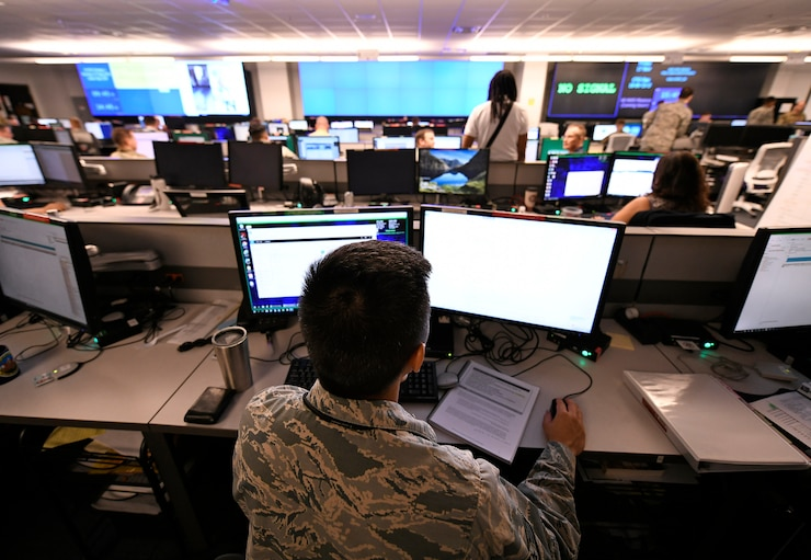 """U.S. Air Force Airmen from the 33rd Network Warfare Squadron conduct cyber operations at Joint Base San Antonio-Lackland, Texas, Aug. 27, 2019. The 33rd NWS utilizes a cyber weapon system that employs more than 40 tools and applications. The """"12N12"""" initiative aims to reduce this number to 12 in 12 months. (U.S. Air Force photo by Tech. Sgt. R.J. Biermann)"""