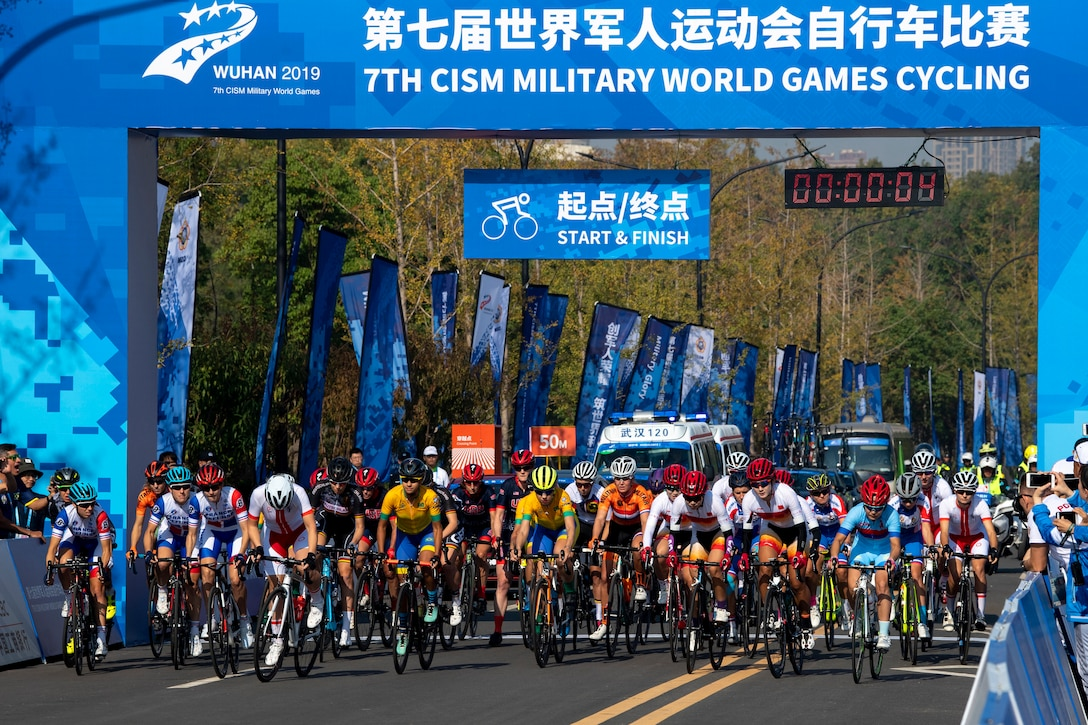 Dozens of cyclists take off from the starting line for a 50-mile road race.