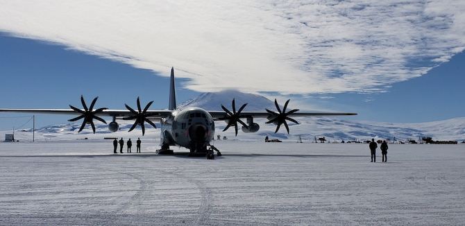 """An LC-130 """"Skibird"""" aircraft, assigned to the 109th Airlift Wing, New York Air National Guard, is parked on the flight line between missions at the National Science Foundation research center at McMurdo Station, Antarctica, Dec. 2, 2018. The 109th AW flies the largest ski-equipped aircraft in the world which can land on snow and ice. (Courtesy photo)"""
