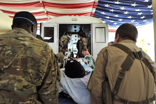 Airmen work with members of the Extracorporeal Membrane Oxygenation team to save the life of a NATO troop at the Craig Joint-Theater Hospital on Bagram Airfield, Afghanistan, Feb. 18, 2016