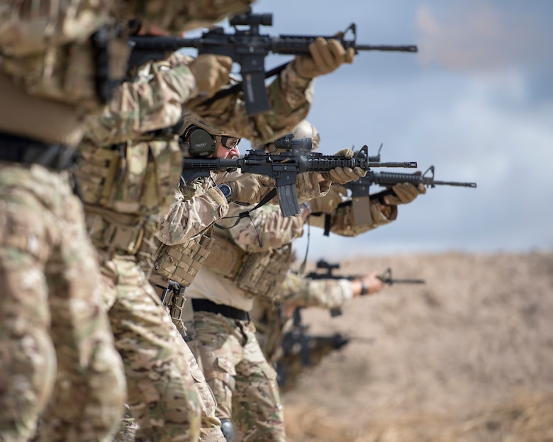Special warfare Airmen fire their M4 carbines during a live-fire exercise