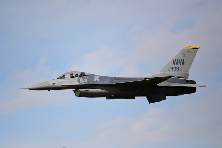 An F-16 Fighting Falcon performs a high-speed pass