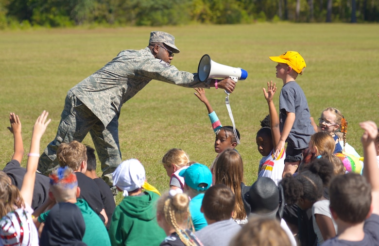 Master Sgt. Maurice Ferguson, a drug demand and reduction program manager assigned to the 315th Aerospace Medical Squadron, leans in to let a student speak into the megaphone, October 23, 2019, at Marrington Elementary School on Joint Base Charleston, S.C. Ferguson was at the school to talk to the children about drug prevention during Red Ribbon Week. Red Ribbon Week, which takes place October 23-31, is an awareness program that began in 1985 as a way to show opposition to drugs as stated by the Get Smart About Drugs foundation.