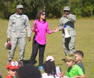 Master Sgt. Maurice Ferguson, a drug demand and reduction program manager assigned to the 315th Aerospace Medical Squadron, Staff Sgt. Christopher Morrison, a program manager with the 628th Force Support Squadron fitness center, and Ann Schuler, a counselor at Marrington Elementary School, speak to the students, October 23, 2019, at Marrington Elementary School on Joint Base Charleston, S.C. Members of Team Charleston were at the school to educate students about Red Ribbon Week and drug prevention. Red Ribbon Week, which takes place October 23-31, is an awareness program that began in 1985 as a way to show opposition to drugs as stated by the Get Smart About Drugs foundation.