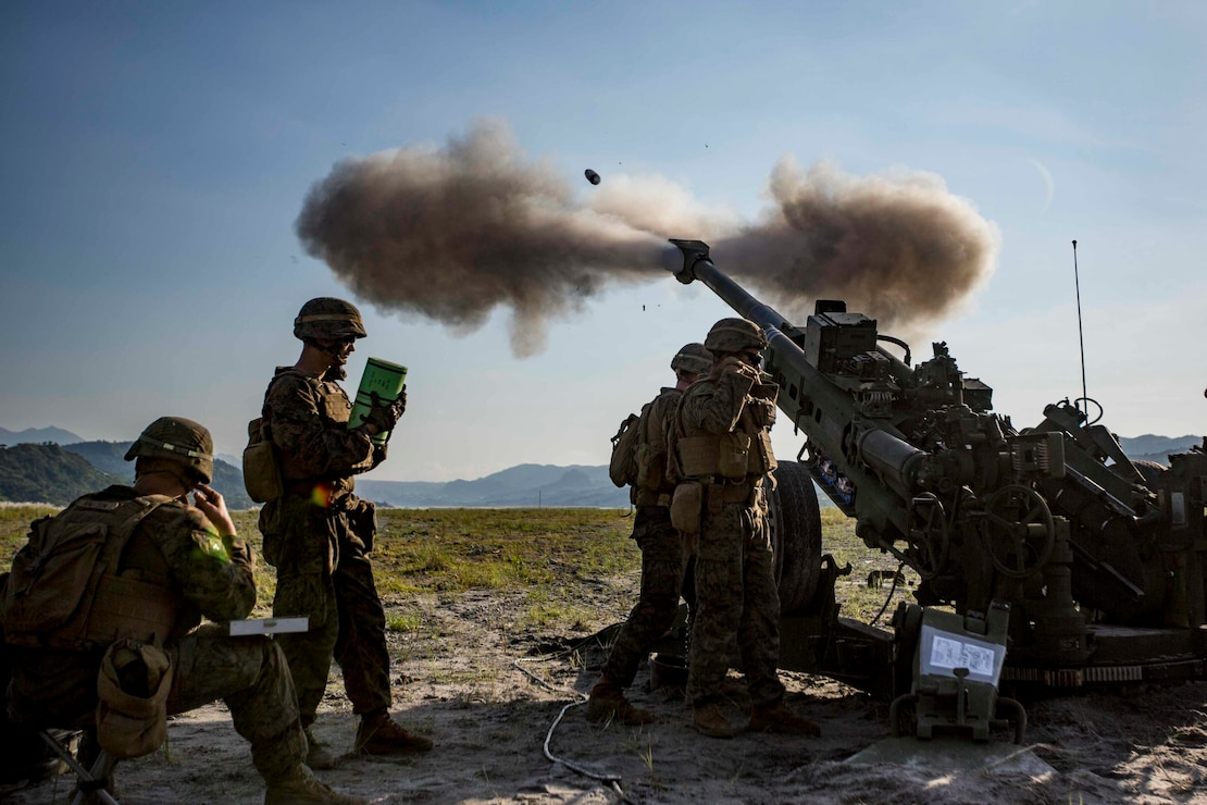 "U.S. Marines with Alpha Battery, Battalion Landing Team, 3rd Battalion, 5th Marine Regiment, 11th Marine Expeditionary Unit, fire an M777 Howitzer during exercise KAMANDAG 3 at Colonel Ernesto P. Ravina Air Base, Philippines, Oct. 13, 2019. KAMANDAG helps participating forces maintain a high level of readiness and responsiveness, and enhances combined military-to-military relations, interoperability, and multinational coordination. KAMANDAG is an acronym for the Filipino phrase ""Kaagapay Ng Mga Manirigma Ng Dagat,"" which translates to ""Cooperation of the Warriors of the Sea,"" highlighting the partnership between the U.S. and Philippine militaries."