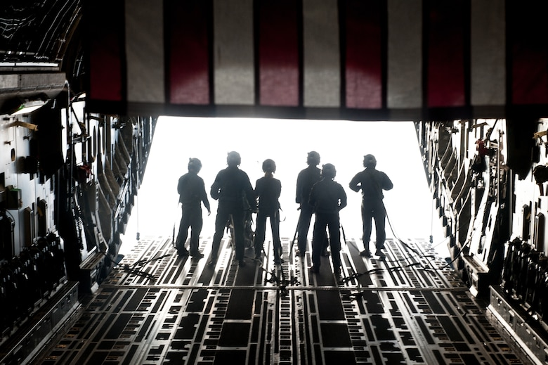 Airmen step toward the ramp of a C-17 Globemaster III