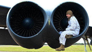 Crew chief inspects the engine of a B-52H Stratofortress
