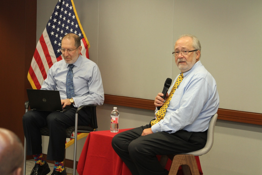 "Steve Schooner and Dave Drabkin, former senior Acquisition civilians, led the Section 809 Panel discussion at the USACE Kansas City District Fall Training on the opening day of the training, October 22, 2019. Their seminar focused on helping contracting professionals make the Federal Acquisition Regulation ""sing"" – work more efficiently."