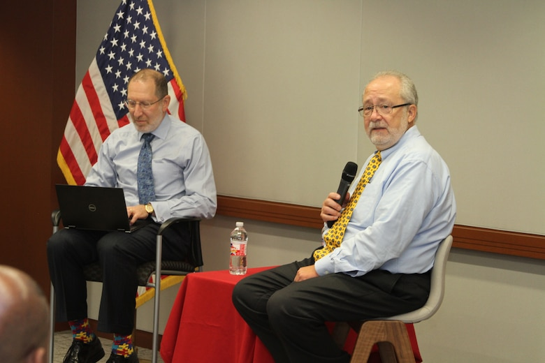 """Steve Schooner and Dave Drabkin, former senior Acquisition civilians, led the Section 809 Panel discussion at the USACE Kansas City District Fall Training on the opening day of the training, October 22, 2019. Their seminar focused on helping contracting professionals make the Federal Acquisition Regulation """"sing"""" – work more efficiently."""