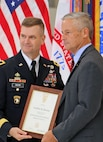 Maj. Gen. Todd Royar, commanding general of the of the U.S. Army Aviation and Missile Command, presents a Certificate of Senior Executive Service to Geoff Downer, director of the AMCOM's Special Programs (Aviation), during a SES appointment ceremony Oct. 18 at Joint Base Langley-Eustis, Virginia.