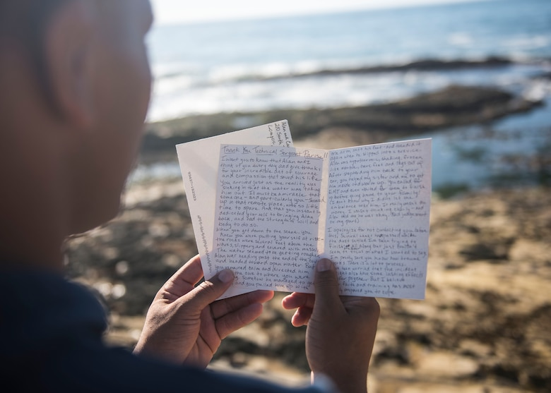 Staff Sgt. Christopher Parise, 576th Flight Test Squadron missile handling evaluator, reads a letter near Wall Beach Oct. 24, 2019, at Vandenberg Air Force Base, Calif. Carla Freeman wrote Parise the letter to thank him for saving the life of her husband Al Freeman, a Vietnam veteran. In the letter, Carla explained that Al has Parkinson's disease and had been feeling depressed lately. She was uncertain as to why Al chose to go out in the ocean that evening, but if it wasn't for Parise, she would have lost the love of her life, and for that, she expressed her full gratitude. (U.S. Air Force photo by Airman 1st Class Aubree Milks)