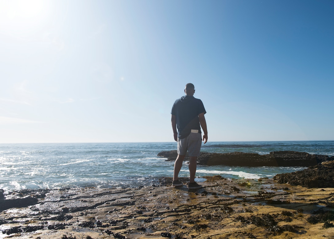 Staff Sgt. Christopher Parise, 576th Flight Test Squadron missile handling evaluator, reflects on a life changing event near Wall Beach Oct. 25, 2019 at Vandenberg Air Force Base, Calif. On Sept. 1, Parise saved a Vietnam veteran, Al Freeman, from nearly dying in the cold ocean waters. Thanks to his military training, Parise knew how to help Al during the dire situation. (U.S. Air Force photo by Airman 1st Class Aubree Milks)