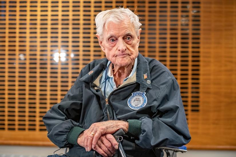An elderly man sitting.