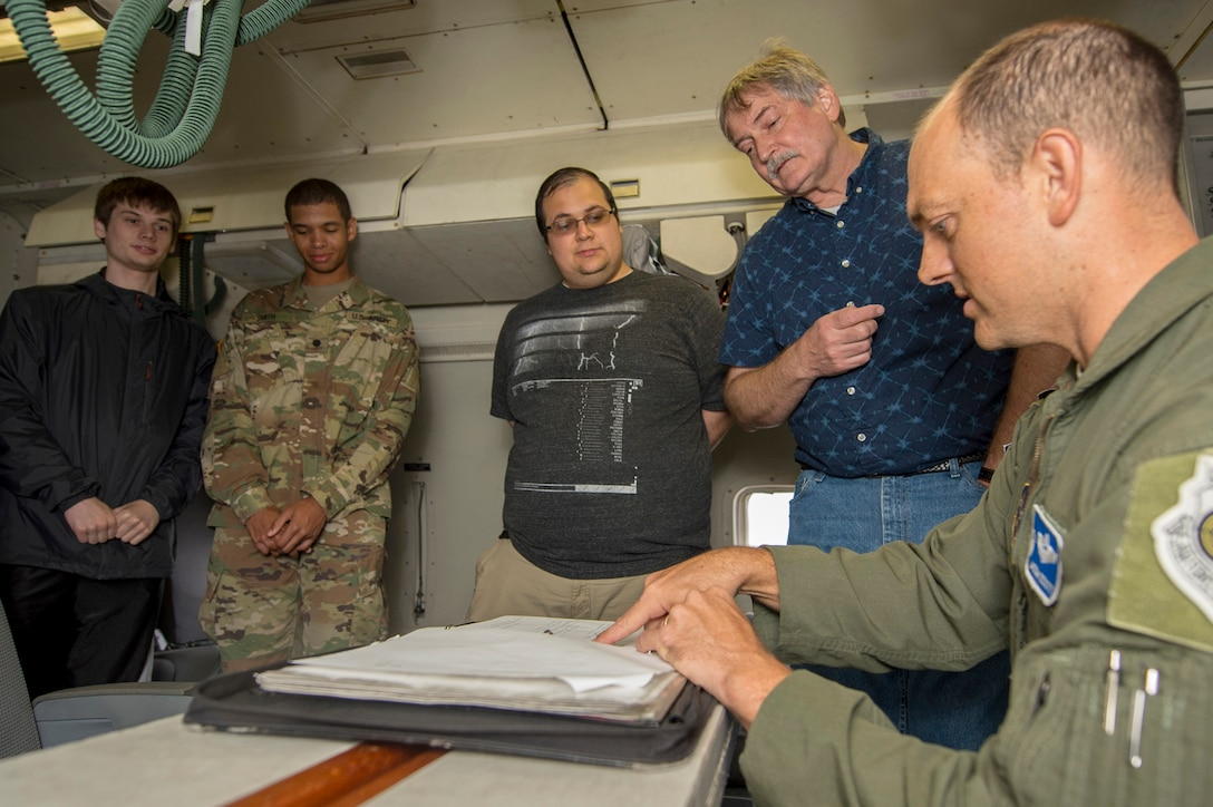 U.S. Air Force Lt. Col. Jason Scott, commander of the 116th Operations Support Squadron, Georgia Air National Guard, explains forms used on an E-8C Joint STARS to Mercer University upperclassmen at Robins Air Force Base, Ga., Oct. 15, 2019. The students from the computer science department worked on an innovation project to help reform the way JSTARS scheduling is run, and a behind-the-scenes look explained some current operating procedures.