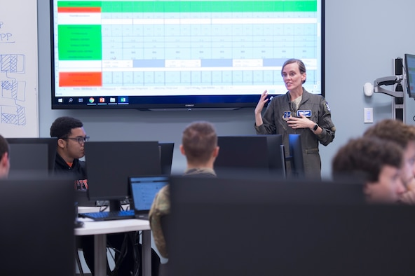 U.S. Air Force Lt. Col. Vanessa Cox, the chief of scheduling with the 116th Operations Support Squadron, Georgia Air National Guard, briefs Mercer University upperclassmen to explain scheduling processes of the E-8C Joint STARS at the Mercer campus in Macon, Ga., Oct. 8, 2019. The students from the computer science department worked on an innovation project to help reform the way JSTARS scheduling is run.