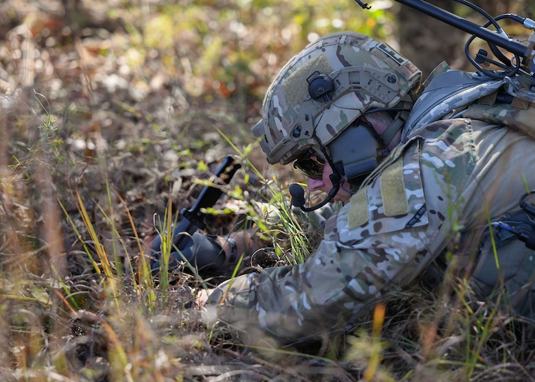 U.S. Air Force Staff Sgt. Htyler Kelley, 19th Civil Engineer Squadron Explosive Ordnance Disposal technician, uncovers a simulated improvised explosive device during a Joint training exercise at Camp Robinson, Arkansas, Oct. 22, 2019.