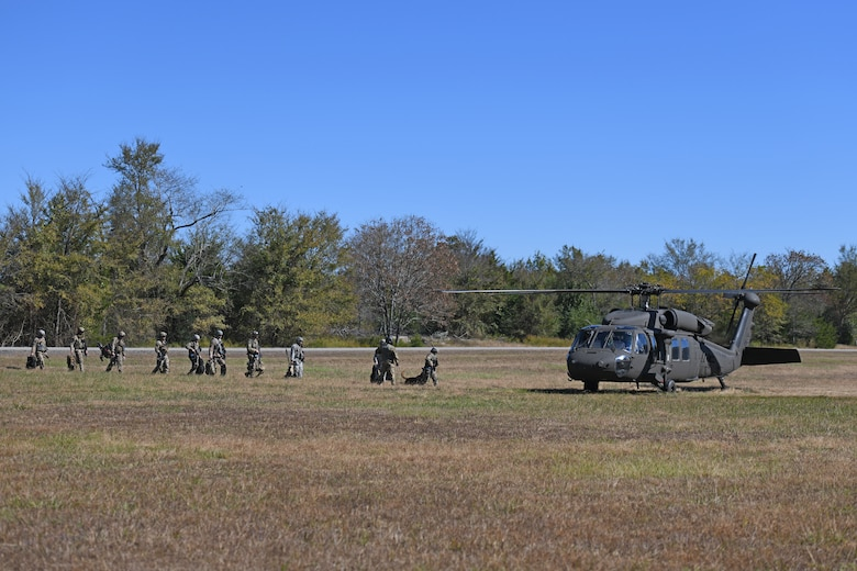 19th Security Forces Squadron defenders and 19th Civil Engineer Squadron Explosive Ordnance Disposal Airmen prepare to board a U.S. Army National Guard UH-60 Black during a Joint training exercise at Little Rock Air Force Base, Arkansas, Oct. 22, 2019.