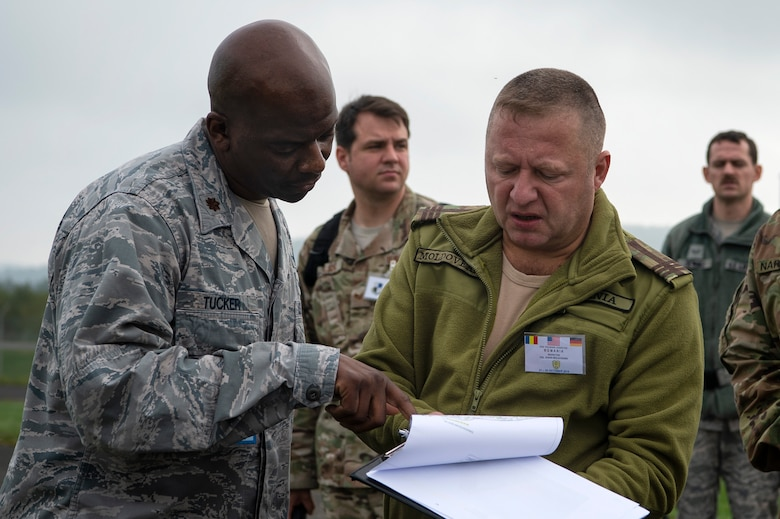 U.S. Air Force Airmen escort Romanian inspection team members during a Conventional Armed Forces in Europe Treaty exercise at Spangdahlem Air Base, Germany, Oct. 24, 2019. The CFE Treaty limits the number of battle tanks, artillery pieces, armored combat vehicles, combat aircraft, and attack helicopters each participating state party can have within the European Area of Application. The exercise was held to make sure the wing is ready for a potential real-world inspection, which can happen with as little as 43 hours' notice. (U.S. Air Force photo by Airman 1st Class Valerie Seelye)