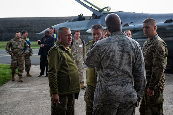 U.S. Air Force Airmen from the 52nd Fighter Wing escort Romanian inspection team members and members of the Defense Threat Reduction Agency during a Conventional Armed Forces in Europe Treaty exercise at Spangdahlem Air Base, Germany, Oct. 24, 2019. In the event of a real-world CFE inspection, the 52nd FW must account for all treaty-limited equipment, including combat aircraft in transit or equipment on cargo aircraft. (U.S. Air Force photo by Airman 1st Class Valerie Seelye)
