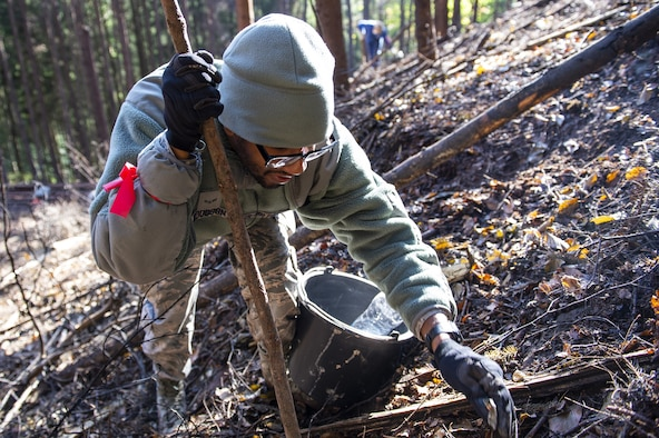 Airmen have worked in the dense wooded area digging through thick vegetation to recover F-16 parts.