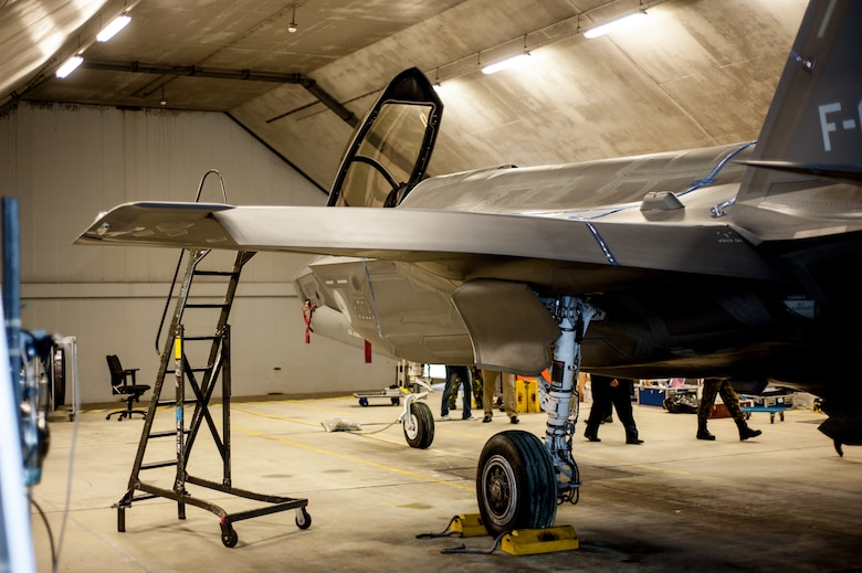 An F-35 is parked inside a hardened aircraft shelter in the Netherlands during a testing session, led by acoustics experts in the Air Force Research Laboratory's 711th Human Performance Wing. The team gathered acoustics data for the Netherlands Royal Air Force by affixing microphones to the fighter's skin with a blue tape-like material and epoxies to avoid damaging the surface coatings, and then running up the engine. (Photo courtesy of Royal Netherlands Air Force)