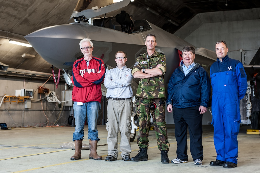 (left to right) Jaap van 't Hof, with the Netherlands TNO Laboratory; Alan Wall, with the U.S. Air Force Research Laboratory; Maj. Arthur L. Driesen, with the Royal Netherlands Air Force; Richard McKinley, with the U.S. Air Force Research Laboratory (now retired); and Theo van Veen, with the Netherlands Aerospace Centre, stand in front of the F-35 used during an acoustics testing session, led by experts in AFRL's 711th Human Performance Wing. (Photo courtesy of Royal Netherlands Air Force)