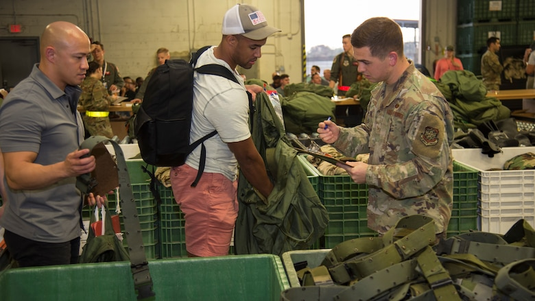 U.S. Senior Airman Justin Auger, a 6th Logistics Readiness Squadron customer service technician, checks an inventory list during an operational readiness exercise Oct. 22, 2019, at MacDill Air Force Base, Fla. The 6th LRS was tasked to exercise their capabilities of readying personnel and cargo during a simulated deployment scenario.