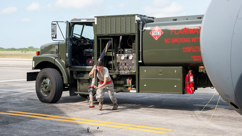U.S. Air Force Airman 1st Class Jesse Booher, a 6th Logistics Readiness Squadron fuels specialist, drags a fuel pump during an operational readiness exercise, Oct. 24, 2019 at MacDill Air Force Base, Fla. The 6th LRS was tasked with providing fuel support to KC-135 aircraft during the ORE.