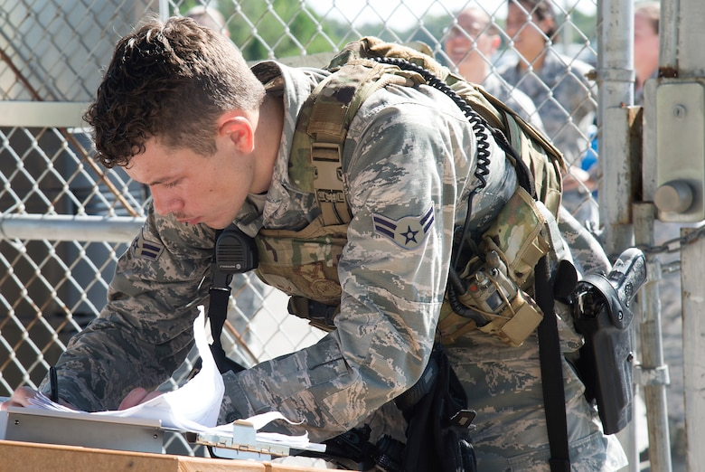 U.S. Air Force Airman 1st Class Fredric Soules, a 6th Security Forces Squadron entry controller, checks a roster during an operational readiness exercise (ORE), Oct. 22, 2019, at MacDill Air Force Base, Fla. The 6th Air Refueling Wing conducted the ORE to ensure proficiency and response times of various units on base during a simulated alert scenario.