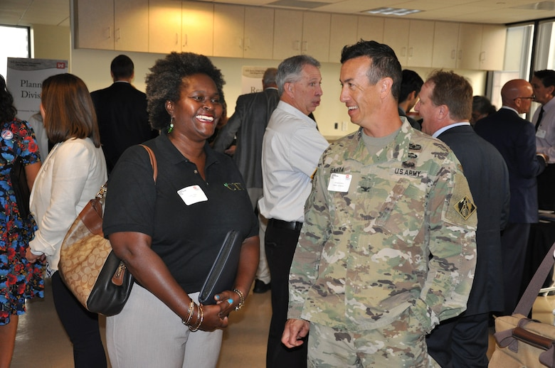 Business representative Robin Thorne discusses potential opportunities with U.S. Army Corps of Engineers Los Angeles District Commander Col. Aaron Barta at the annual Business Opportunities Open House Oct. 9 in the District's downtown LA headquarters.