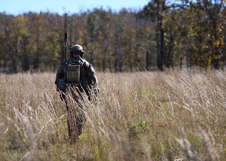 U.S. Air Force Staff Sgt. Htyler Kelley, 19th Civil Engineer Squadron Explosive Ordnance Disposal technician, uses a metal detector to search for simulated improvised explosive devices during a Joint training exercise at Camp Robinson, Arkansas, Oct. 22, 2019.
