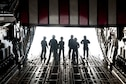 Airmen step toward the ramp of a C-17 Globemaster III