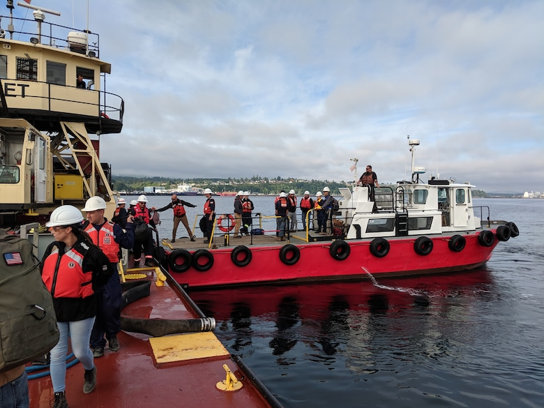 Students participating in the Northwest Oil Spill Control Course transfer from an Arrow Launch Service vessel to the M/V Puget. As part of an international cooperation to prepare for a hazardous spill response on Puget Sound, Seattle District participated in the Northwest Oil Spill Control Course hosted by the United States Coast Guard, District 13 August 26-30. (USACE photo by Brad Schultz)