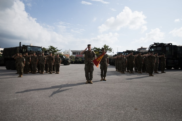 U.S. Marines with Truck Company, Headquarters Battalion, 3rd Marine Division, stand in formation during a change of command ceremony on Camp Hansen, Okinawa, Japan, Oct. 25, 2019. The ceremony was held for U.S. Marine Corps Capt. Matthew Dorton, the oncoming company commander for Truck Company, who relieved U.S. Marine Corps Capt. Marie Banks, the outgoing company commander of Truck Company. During the ceremony, the transfer of the company colors, symbolizing the transfer of responsibility and authority of Truck Company, was performed by the outgoing and incoming commanders.
