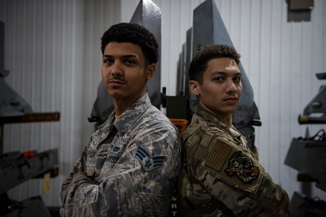 Fraternal twins Jordan and Quinn Harrison, both Senior Airmen from the 51st Munitions Squadron, pose for a photo, Oct. 25, 2019, at Osan Air Base, Republic of Korea.(U.S. Air Force photo by Staff Sgt. Gregory Nash)