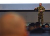 Chief Master Sgt. Steve Cenov, 8th Fighter Wing command chief, speaks to Wolf Pack members about multi-domain operations at Kunsan Air Base, Republic of Korea, Oct. 25, 2019. Multi-domain operations include not only being able to fight on land, in the air and at sea but also in space and cyberspace. (U.S. Air Force photo by Staff Sgt. Anthony Hetlage)