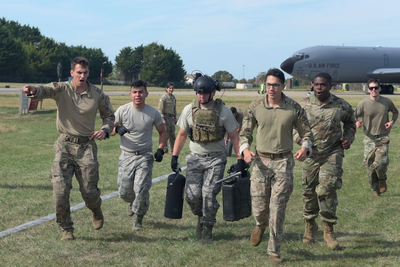 Airmen assigned to the 100th Logistics Readiness Squadron run together during a Forward Area Refueling Point team tryout at RAF Mildenhall, England, Sept. 13, 2019. During FARP training, members wear full body armor to simulate encounters they may face downrange while refueling. (U.S. Air Force photo by Senior Airman Benjamin Cooper)