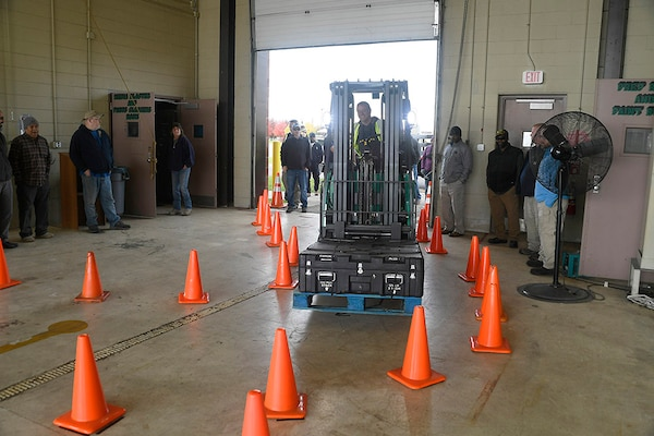 Trainer Don Zimmermann navigates a warehouse obstacle course during a safe operation demonstration at the MHE Safety Summit Oct. 25.